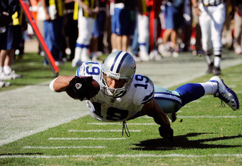 SAN FRANCISCO, CA - SEPTEMBER 18: Miles Austin #19 of the Dallas Cowboys dives into the endzone to finish off a 25 yard catch and run for a touchdown against the San Francisco 49ers in the fourth quarter of an NFL football game at Candlestick Park on Sept