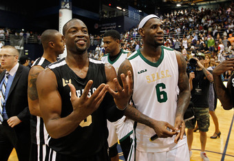 MIAMI, FL - OCTOBER 08:   Dwyane Wade and LeBron James address the fans during the South Florida All Star Classic at Florida International University on October 8, 2011 in Miami, Florida.  (Photo by Mike Ehrmann/Getty Images)