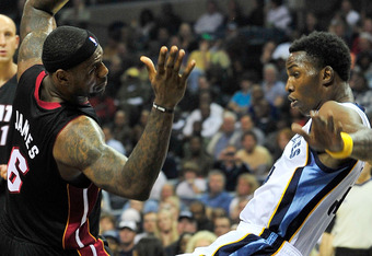 MEMPHIS, TN - NOVEMBER 20:  LeBron James #6 of the Miami Heat draws a blocking foul on Hasheem Thabeet #34 of the Memphis Grizzlies at FedExForum on November 20, 2010 in Memphis, Tennessee.  NOTE TO USER: User expressly acknowledges and agrees that, by do