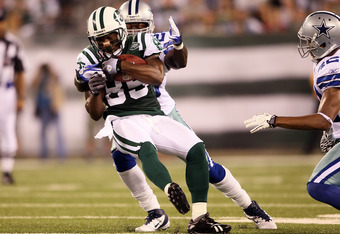 EAST RUTHERFORD, NJ - SEPTEMBER 11:  Derrick Mason #85 of the New York Jets makes a recpetion against the Dallas Cowboys during their NFL Season Opening Game at MetLife Stadium on September 11, 2011 in East Rutherford, New Jersey.  (Photo by Elsa/Getty Im
