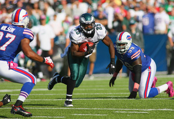 ORCHARD PARK, NY - OCTOBER 09: LeSean McCoy #25 of the Philadelphia Eagles runs between Marcell Dareus #99 and George Wilson #37 of the Buffalo Bills at Ralph Wilson Stadium on October 9, 2011 in Orchard Park, New York. Buffalo won 31-24.  (Photo by Rick