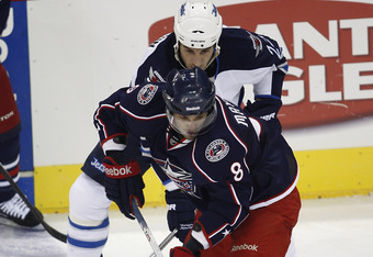 COLUMBUS, OH - SEPTEMBER 20:  Maksim Mayorov #8 of the Columbus Blue Jackets controls the puck during the game against the Winnipeg Jets on September 20, 2011 at Nationwide Arena in Columbus Ohio.  The Blue Jackets defeated the Jets 5-1.  (Photo by John G