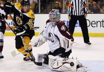 BOSTON, MA - OCTOBER 10:  Semyon Varlamov #1 of the Colorado Avalanche stops a shot by Brad Marchand #63 of the Boston Bruins on October 10, 2011 at TD Garden in Boston, Massachusetts.  (Photo by Elsa/Getty Images)