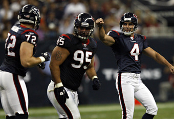 HOUSTON - AUGUST 20:  Kicker Neil Rackers #4 of the Houston Texans celebrates after hitting a 49 yard field goal in the second quarter against the New Orleans Saints at Reliant Stadium on August 20, 2011 in Houston, Texas.  (Photo by Bob Levey/Getty Image