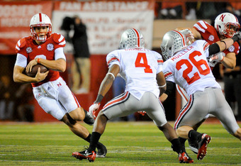 LINCOLN, NE - OCTOBER 8: Quarterback Taylor Martinez #3 of the Nebraska Cornhuskers tries to avoid defensive back C.J. Barnett #4 of the Ohio State Buckeyes and linebacker Tyler Moeller #26 of the Ohio State Buckeyes during their game at Memorial Stadium