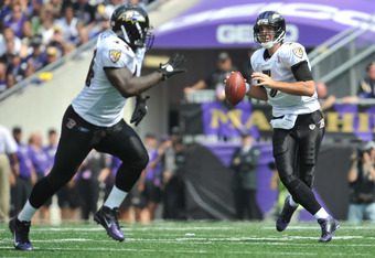 BALTIMORE, MD - SEPTEMBER 11:  Joe Flacco #5 of the Baltimore Ravens looks to pass against the Pittsburgh Steelers at M&T Bank Stadium on September 11, 2011 in Baltimore, Maryland. The Ravens defeated the Steelers 35-7. (Photo by Larry French/Getty Images