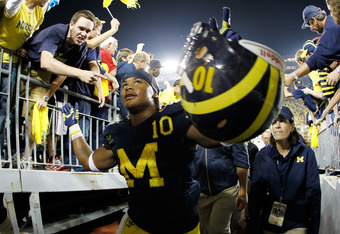 ANN ARBOR, MI - SEPTEMBER 10: Jeremy Gallon #10 of the Michigan Wolverines celebrate with fans while leaving the field after beating the Notre Dame Fighting Irish 35-31 at Michigan Stadium on September 10, 2010 in Ann Arbor, Michigan. (Photo by Gregory Sh