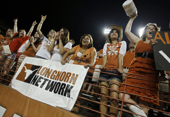 AUSTIN, TX - SEPTEMBER 3:  University of Texas fans cheer on the Longhorns as they play the Rice Owls on September 3, 2011 at Darrell K. Royal-Texas Memorial Stadium in Austin, Texas.  This was the debut game for the new Longhorn Network, a partnership be