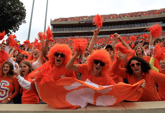 CLEMSON, SC - SEPTEMBER 17:  Fans cheer on the Clemson Tigers during their game against the Auburn Tigers at Memorial Stadium on September 17, 2011 in Clemson, South Carolina.  (Photo by Streeter Lecka/Getty Images)
