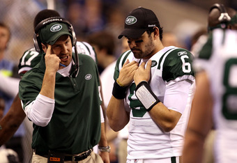 INDIANAPOLIS, IN - JANUARY 08:  Offensive coordinator Brian Schottenheimer of the New York Jets gestures as he talks to quarterback Mark Sanchez #6 late in the fourth quarter against the Indianapolis Colts during their 2011 AFC wild card playoff game at L