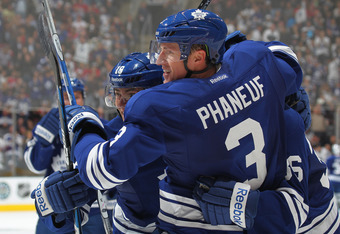 TORONTO, CANADA - OCTOBER 6:  Dion Phaneuf #3 of the Toronto Maple Leafs celebrates his goal in a game against the Montreal Canadiens on October 6, 2011 at the Air Canada Centre in Toronto, Canada. The Leafs defeated the Canadiens 2-0. (Photo by Claus And
