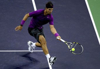 SHANGHAI, CHINA - OCTOBER 12:  Rafael Nadal of Spain chases down a drop shot while playing Guillermo Garcia-Lopez of Spain during the Shanghai Rolex Masters at the Qi Zhong Tennis Center on October 12, 2011 in Shanghai, China.  (Photo by Matthew Stockman/