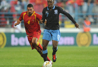 PODGORICA, MONTENEGRO - OCTOBER 07:  Daniel Welbeck of England in action with Milan Jovanovic of Montenegro during the EURO 2012 group G qualifier match between Montenegro and England at the Gradski Stadium on October 7, 2011 in Podgorica, Montenegro.  (P