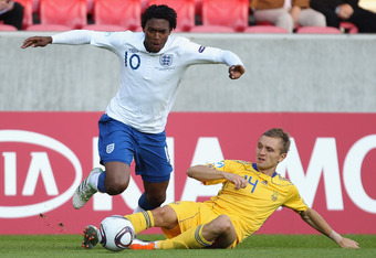 HERNING, DENMARK - JUNE 15:  Oleg Golodyuk of Ukraine tries to tackle Daniel Sturridge of England during the UEFA European Under-21 Championship Group B match between Ukraine and England at the Herning Stadium on June 15, 2011 in Herning, Denmark.  (Photo