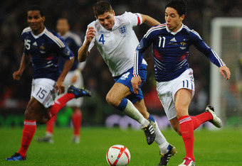 LONDON, ENGLAND - NOVEMBER 17:  Samir Nasri of France is chased by Steven Gerrard of England during the international friendly match between England and France at Wembley Stadium on November 17, 2010 in London, England.  (Photo by Laurence Griffiths/Getty