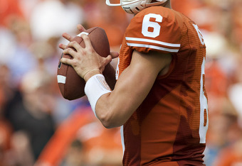 DALLAS, TX - OCTOBER 8:   Quarterback Case McCoy #6 of the Texas Longhorns drops back to pass against the Oklahoma Sooners at the Cotton Bowl on October 8, 2011 in Dallas, Texas.  The Sooners defeated the Longhorns 55 to 17.  (Photo by Wesley Hitt/Getty I