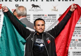 LAS VEGAS - SEPTEMBER 12:  Boxer Juan Manuel Marquez of Mexico holds a Mexican flag during his official weigh-in at the MGM Grand Garden Arena September 12, 2008 in Las Vegas, Nevada. Marquez will face Joel Casamayor of Cuba in a 12-round fight on Septemb