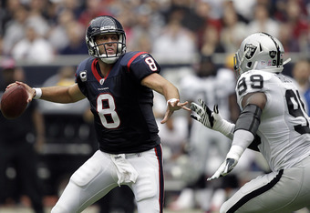 HOUSTON - OCTOBER 09: Quarterback Matt Schaub #8 of the Houston Texans throws under pressure from Lamarr Houston #99 of the Oakland Raiders at Reliant Stadium on October 9, 2011 in Houston, Texas. (Photo by Bob Levey/Getty Images)
