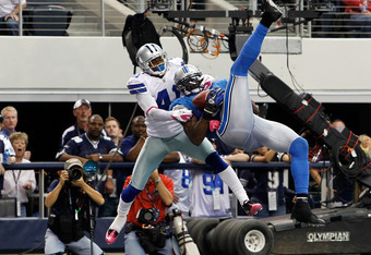 ARLINGTON, TX - OCTOBER 02:  Calvin Johnson #81 of the Detroit Lions pulls in the game-winning touchdown against  Terence Newman #41 of the Dallas Cowboys at Cowboys Stadium on October 2, 2011 in Arlington, Texas. The Lions beat the Cowboys 34-30.  (Photo