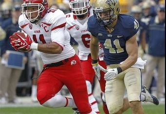 Utah's Luke Matthews catches a tip pass by Pitt's Max Gruder for Utah's first touchdown. (AP Photo/Keith Srakocic)