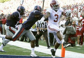 OXFORD, MS - OCTOBER 15:  Running back Trent Richardson #3 of the Alabama Crimson Tide runs in for a touchdown past cornerback Marcus Temple #4 of the Mississippi Rebels October 15, 2011 at Vaught-Hemingway Stadium in Oxford, Mississippi. (Photo by Butch