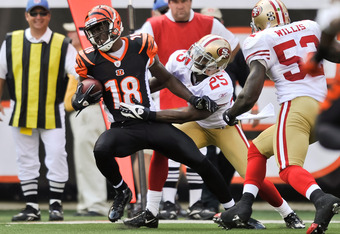 CINCINNATI, OH - SEPTEMBER 25:  A.J. Green #18 of the Cincinnati Bengals runs with the ball after making a catch against the San Francisco 49ers at Paul Brown Stadium on September 25, 2011 in Cincinnati, Ohio.  (Photo by Jamie Sabau/Getty Images)