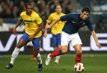 PARIS, FRANCE - FEBRUARY 09:  Yoann Gourcuff of France beats Elias of Brazil during the International friendly match between France and Brazil at Stade de France on February 9, 2011 in Paris, France.  (Photo by Alex Livesey/Getty Images)