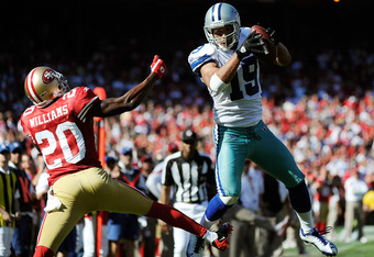 SAN FRANCISCO, CA - SEPTEMBER 18: Miles Austin #19 of the Dallas Cowboys catches the ball in front of Madieu Williams #20 of the San Francisco 49ers and carries the ball into the endzone for a 25 yard touchdown in the fourth quarter of an NFL football gam