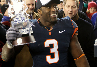 NEW YORK, NY - DECEMBER 30: Delone Carter #3 of the Syracuse Orange celebrates winning the MVP trophy after defeating the Kansas State Wildcats during the New Era Pinstripe Bowl at Yankee Stadium on December 30, 2010 in New York, New York.  (Photo by Chri