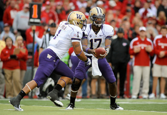 LINCOLN, NE - SEPTEMBER 17: Keith Price #17 hands the ball to Chris Polk #1 of the Washington Huskies during their game at Memorial Stadium September 17, 2011 in Lincoln, Nebraska. Nebraska won 51-38.(Photo by Eric Francis/Getty Images)