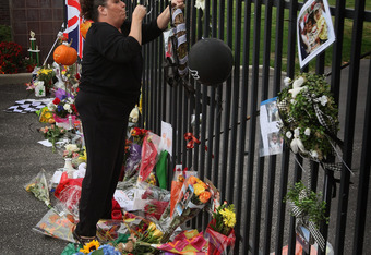 Fans place flowers, notes, pictures, and milk for their fallen Champion outside the Indianapolis Motor Speedway.