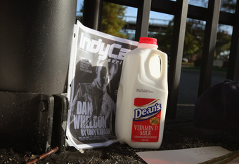INDIANAPOLIS, IN - OCTOBER 17:  A jug of milk is sits at the gate of the Indianapolis Motor Speedway along with other tributes left by fans to two-time Indianapolis 500 winner Dan Wheldon on October 17, 2011 in Indianapolis, Indiana. Wheldon, winner of th