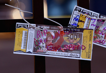 INDIANAPOLIS, IN - OCTOBER 17:  Ticket stubs from the 2011 Indianapolis 500 are attacvhed to the gate at the Indianapolis Motor Speedway where other fans had left tributes to two-time Indianapolis 500 winner Dan Wheldon on October 17, 2011 in Indianapolis