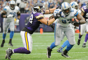 MINNEAPOLIS, MN - SEPTEMBER 25: Chad Greenway #52 of the Minnesota Vikings tackles Brandon Pettigrew #87 of the Detroit Lions in the fourth quarter on September 25, 2011 at Hubert H. Humphrey Metrodome in Minneapolis, Minnesota. The Lions defeated the Vik