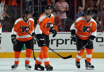 PHILADELPHIA, PA - SEPTEMBER 26: Jaromir Jagr #68 (C) of the Philadelphia Flyers returns to the bench with Danny Briere #48 (L) and Claude Giroux #28 (R) following his power play goal at 9:25 of the first period against the New York Raqngers during an NHL