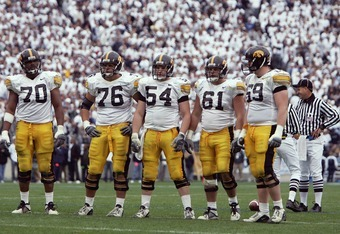 STATE COLLEGE, PA - OCTOBER 23:  Iowa Hawkeyes offensive linemen Lee Gray #70, Mike Jones #76, Mike Elgin #54, Brian Ferentz #61, and Peter McMahon #69 wait for play to resume against the Penn State Nittany Lions at Beaver Stadium on October 23, 2004 in S