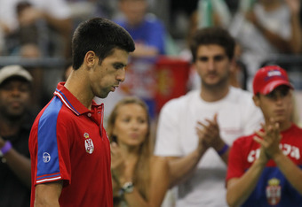BELGRADE, SERBIA - SEPTEMBER 18: Novak Djokovic of Serbia reacts after losing a point against Juan Martin Del Potro of Argentina during the Davis Cup singles semi final between Serbia and Argentina, at Belgrade Arena on September 18, 2011 in Belgrade, Ser