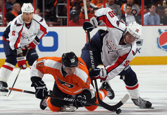 PHILADELPHIA, PA - OCTOBER 20: Brayden Schenn #10 of the Philadelphia Flyers is knocked down on the faceoff by Marcus Johansson #90 of the Washington Capitals at the Wells Fargo Center on October 20, 2011 in Philadelphia, Pennsylvania. The Capitals defeat