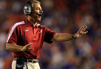 GAINESVILLE, FL - OCTOBER 01:  Head coach Nick Saban of the Alabama Crimson Tide holds out his hand during a game against the Florida Gators  at Ben Hill Griffin Stadium on October 1, 2011 in Gainesville, Florida.  (Photo by Sam Greenwood/Getty Images)