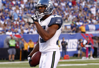 EAST RUTHERFORD, NJ - OCTOBER 09:   Doug Baldwin #15 of the Seattle Seahawks gestures to the crowd after running in for a touchdown against the New York Giants at MetLife Stadium on October 9, 2011 in East Rutherford, New Jersey.  (Photo by Jeff Zelevansk