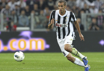 TURIN, ITALY - OCTOBER 02:  Giorgio Chiellini of Juventus FC in action during the Serie A match between Juventus FC and AC Milan on October 2, 2011 in Turin, Italy.  (Photo by Marco Luzzani/Getty Images)