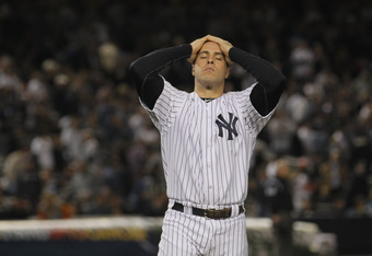NEW YORK, NY - OCTOBER 06:  Mark Teixeira #25 of the New York Yankees reacts after he was stranded on first base when Nick Swisher #33 struck out with the bases loaded to end the bottom of the seventh inning during Game Five of the American League Champio