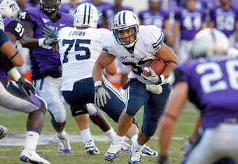 FORT WORTH, TX - OCTOBER 16:  Running back Bryan Kariya #33 of the BYU Cougars carries the ball against the TCU Horned Frogs at Amon G. Carter Stadium on October 16, 2010 in Fort Worth, Texas. TCU beat BYU 31-3.  (Photo by Tom Pennington/Getty Images)