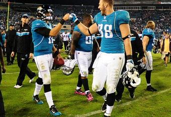 JACKSONVILLE, FL - OCTOBER 24:  Blaine Gabbert #11 of the Jacksonville Jaguars celebrates with Zach Potter #88 after the game against the Baltimore Ravens at EverBank Field on October 24, 2011 in Jacksonville Florida. (Photo by Scott Cunningham/Getty Imag