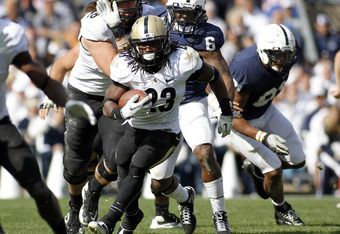 STATE COLLEGE, PA - OCTOBER 15:  Ralph Bolden #23 of the Purdue Boilermakers carries the ball against the Penn State Nittany Lions during the game on October 15, 2011 at Beaver Stadium in State College, Pennsylvania.  The Nittany Lions defeated the Boiler