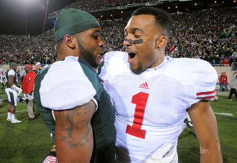 EAST LANSING, MI - OCTOBER 22:  B.J. Cunningham #3 of the Michigan State Spartans and Nick Toon #1 of the Wisconsin Badgers talk together on the field after the game at Spartan Stadium on October 22, 2011 in East Lansing, Michigan. The Spartans defeated t