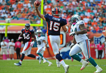 MIAMI GARDENS, FL - OCTOBER 23: Tim Tebow #15 of the Denver Broncos passes against the Miami Dolphins at Sun Life Stadium on October 23, 2011 in Miami Gardens, Florida. (Photo by Scott Cunningham/Getty Images)