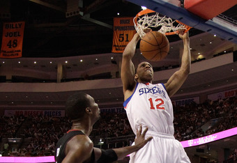 PHILADELPHIA, PA - APRIL 24: Evan Turner #12 of the Philadelphia 76ers dunks in front of Chris Bosh #1 of the Miami Heat during the second half of Game Four of the Eastern Conference Quarterfinals in the 2011 NBA Playoffs at Wells Fargo Center on April 24