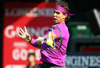 TOKYO, JAPAN - OCTOBER 09: Rafael Nadal of Spain plays a backhand in the men's final match against Andy Murray of Great Britain during the day seven of the Rakuten Open at Ariake Colosseum on October 9, 2011 in Tokyo, Japan. (Photo by Koji Watanabe/Getty