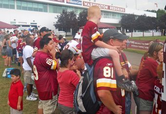 Redskins fans wait to get a glimpse of players at training camp. Photo by Mike Frandsen.